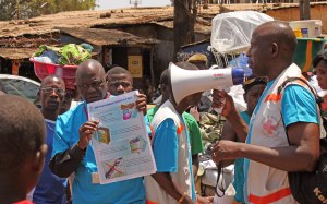 UN workers teaching the public about Ebola symptoms and how the virus is spread.