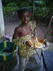 My counterpart's daughter, Oumou, with some food for me.